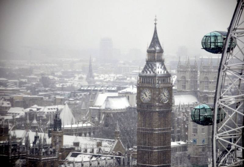 View of the snow covered Big Ben and London Eye